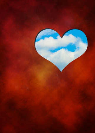 The cut out in red hearts against blue sky