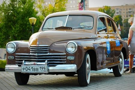 """superleggera: MOSCOW – JULY 31: Brown GAZ Pobeda (vintage USSR car) on exhibition parking night rally of retro-cars """"Night Moscow Classic Rally-2010"""""""
