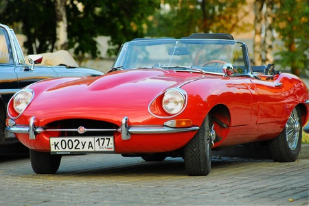 MOSCOW-JULY 31: Red Jaguar E-Type. Modelyear 1963, on exhibition parking on exhibition parking night rally of retro-cars Night Moscow Classic Rally-2010
