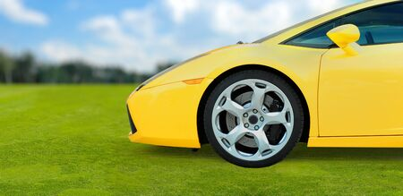 Yellow Luxury Sport Car outdoor on green grass