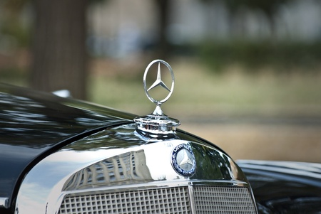 MOSCOW-JULY 31:  Annual event Night Moscow Classic Rally, - the VI race of vintage cars, more than 50 crews, from owners to celebrities. Mercedes-Benz emblem. July 31, 2010 in Moscow, Russia Editorial