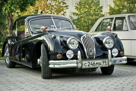 MOSCOW - JULY 31: Black Jaguar XK120 Classic on exhibition parking at an annual event the VI race of vintage cars Night Moscow Classic Rally. July 31, 2010 in Moscow, Russia