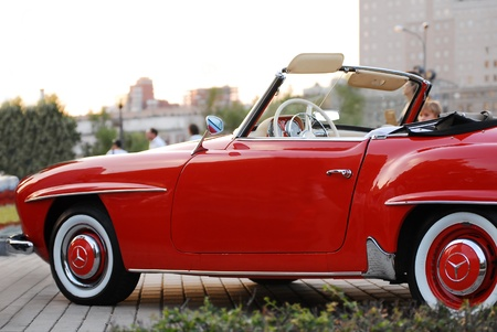 superleggera: MOSCOW-JULY 31: Red Mercedes-Benz 190 SL on exhibition parking at an annual event Night Moscow Classic Rally. The sixth race of vintage cars, more than 50 crews, from owners to celebrities. July 31, 2010 in Moscow, Russia Editorial