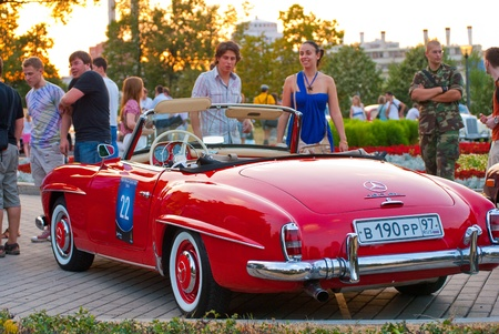 MOSCOW-JULY 31: Red Mercedes-Benz 190 SL on exhibition parking at an annual event, the VI race of vintage cars Night Moscow Classic Rally. July 31, 2010 in Moscow, Russia