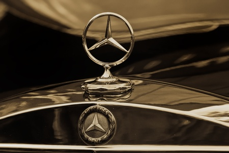MOSCOW - MAY 15: Mercedes-Benz emblem logo sepia on exhibition at «Mercedes-Benz Classic Day-2010», massive oldtimer rally, Moscow, Russia, on May 15, 2010 Editorial