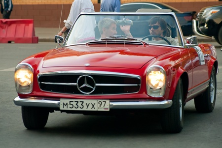 MOSCOW - MAY 15: unidentified man in red vintage Mercedes on exhibition at Mercedes-Benz Classic Day-2010, massive oldtimer rally, Moscow, Russia, on May 15, 2010 Editorial