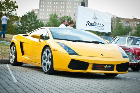 MOSCOW, RUSSIA-JULY 31: Yellow Lamborghini on exhibition parking at an annual event, the VI race of vintage cars Night Moscow Classic Rally. July 31, 2010 in Moscow, Russia