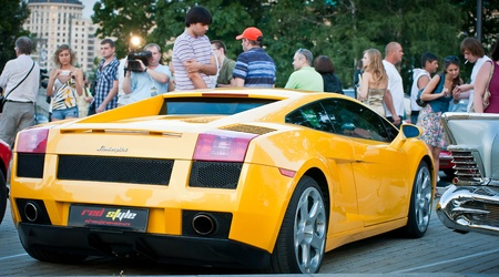 superleggera: MOSCOW, RUSSIA-JULY 31: Yellow Lamborghini on exhibition parking at an annual event, the VI race of vintage cars Night Moscow Classic Rally. July 31, 2010 in Moscow, Russia Editorial