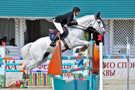 MOSCOW, RUSSIA - JUNE 26:rider Varna Andis(LAT) at the latvian horse Marmors in stage of the International event CSI4*RR Russian Championship Show Jumping on June 26, 2011 in Moscow, Russia Editorial