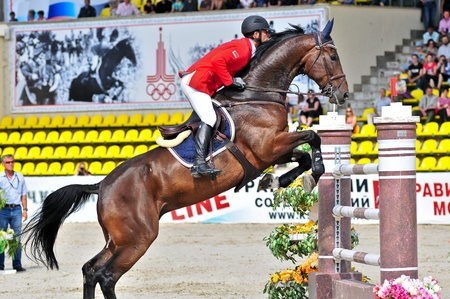 MOSCOW, RUSSIA-JUNE 26: Rider Morotsky Egor(BLR) with a Dutch Warmblood horse Vakantos competes at the International event CSI4*RR Russian Championship Show Jumping on June 26, 2011 in Moscow, Russia Editorial