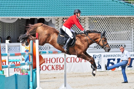 MOSCOW, RUSSIA - JUNE 26: Rider Simony Natalia (RUS) wit a Budenov's horse Gardemarin competes at the International event CSI4*RR/ Russian Championship Show Jumping on June 26, 2011 in Moscow, Russia Stock Photo - 11302238