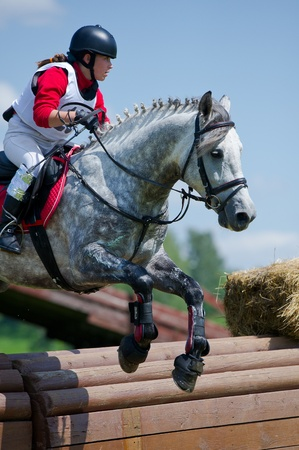 MOSCOW - JUNE 02  Unidentified rider on horse is overcomes the obstacle at the International Eventing Competition CCI3  2  1  �Russian Cup Eventing� June 02, 2012 in Moscow, Russia