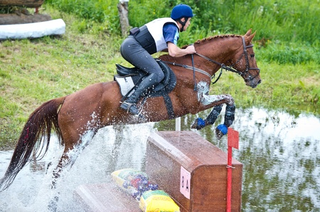 MOSCOW - JUNE 02  Unidentified rider on horse is overcomes the obstacle at the International Eventing Competition CCI3