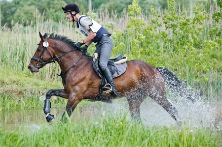 eventing: MOSCOW - JUNE 02  Unidentified rider on horse is overcomes the obstacle at the International Eventing Competition CCI3 Editorial