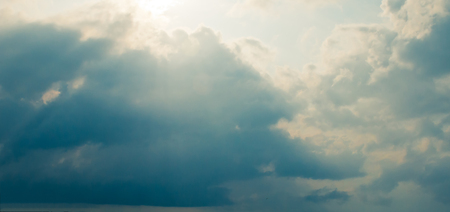 Storm clouds and sunrays photo