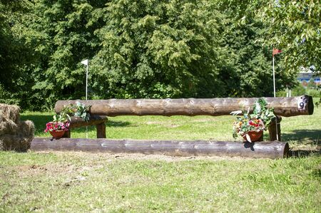 A cross-country a Log fences obstacles in a cross country event Stock Photo