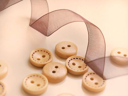 Wooden colored buttons in white background