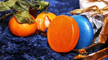 Fresh orange, orange soap. Clean and care