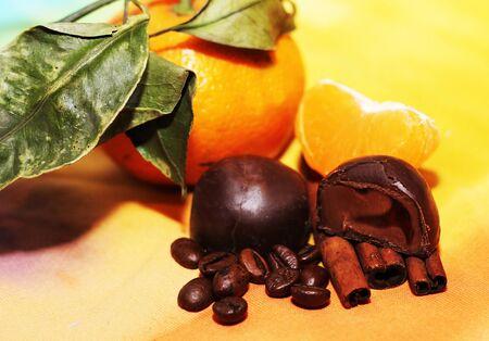 orange and cinnamon sticks, sweet dark chocolates Stock Photo
