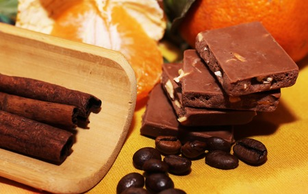 orange and cinnamon sweet dark chocolates happy new year stock photo 70800617