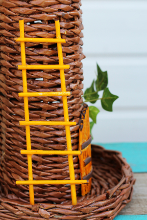 Yellow staircase handmade on a wicker tower, nature Stock Photo