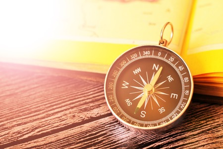Map with compass. Simple navigation tools to orient in the world. Travel. Stock Photo