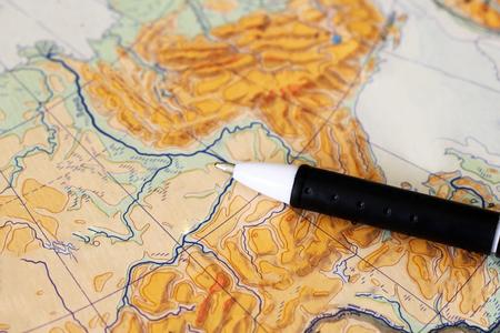Handle on the world map set traveler, object
