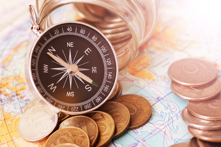 Compass and money on the map,a set of traveler, object