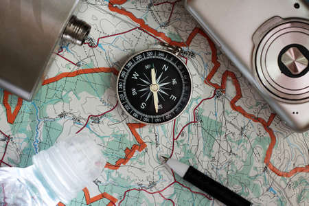 Compass and a camera on the map, object
