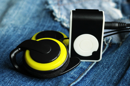 Yellow music player and beautiful overhead headphones, lux