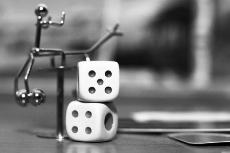 two white dices and metal toy, object Stock Photo
