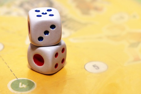 Gambling dices isolated on game paper, toys Stock Photo