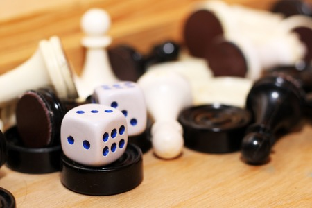 A pair white of dice and chess, toys