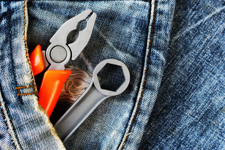 Jean with equipment, repair tools in the pocket of your pants