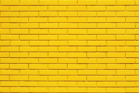 Yellow brick wall background, copy space, outdoor 免版税图像