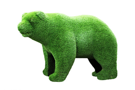 Green grass bear sculpture. Symbol of Russia. Isolated