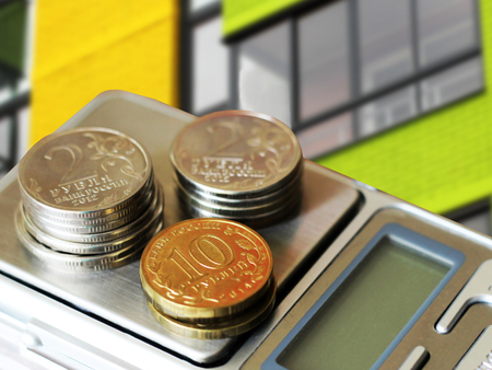 The facade of a residential high-rise house on a background of money . The concept of selling in the real estate market Stock Photo
