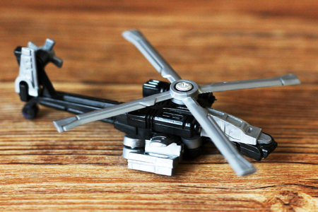 Toy Military Helicopter on wooden table, object