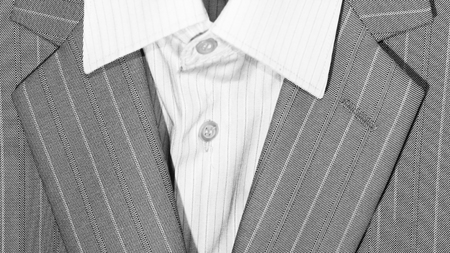 Closeup of suit buttons and lapel for business or formal wear, grey color Stock Photo