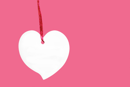 paper heart sign with rope isolated on pink background, price