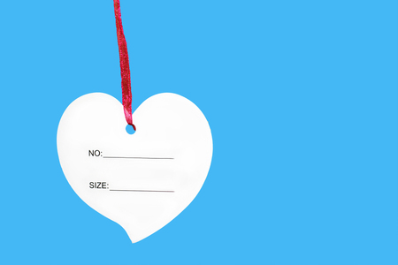 paper heart sign with rope isolated on blue background, price Stock Photo
