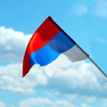 Russian flag waving on wind, blue sky