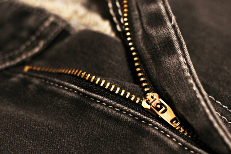 Jeans with broken lock zipper. Metal object.