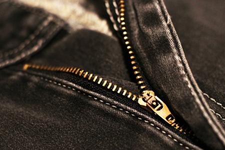 Jeans with broken lock zipper. Metal object.