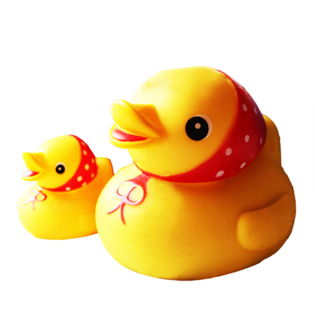 Yellow rubber duck, rubber bathing toy, isolated