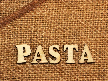 Italian pasta and lettering wooden letters, food