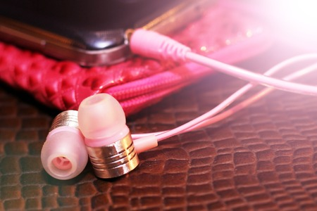 pink headphones and the smartphone, close-up, toned Stock Photo