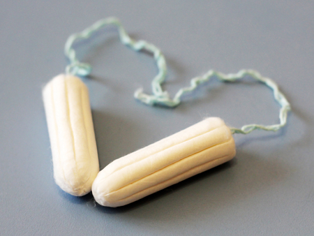 two female hygienic tampons on blue background, heart Stock Photo