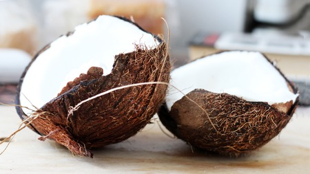coconuts on natural old wood table background, exotic