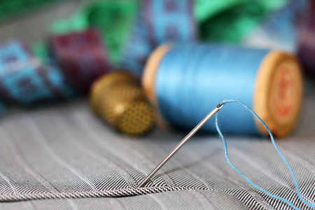 needle with thread and buttons, hobby object